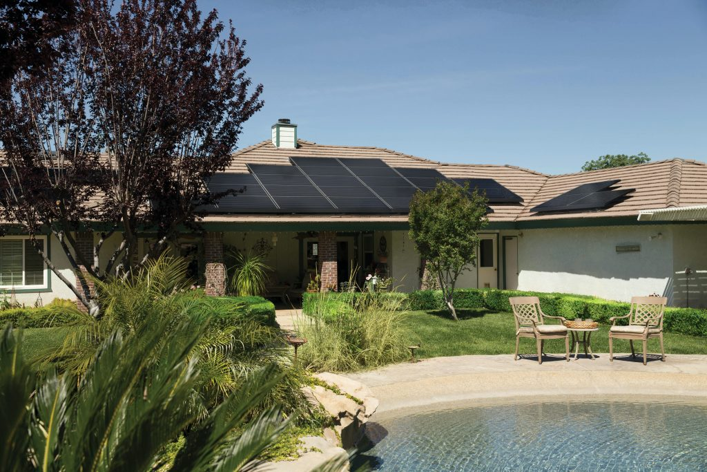 black-solar-panels-on-brown-roof